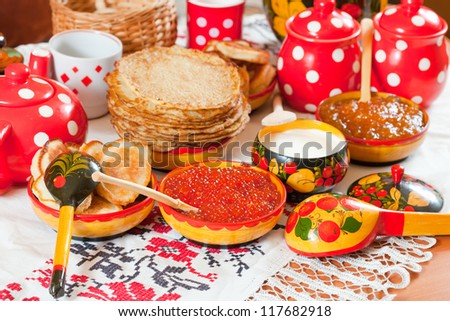 Traditional russian pancake with caviar and tea