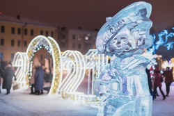 Traditional Russian sculptures and figures carved from blocks of ice at the celebration of the 2021 New Year on the city's Christmas Tree.