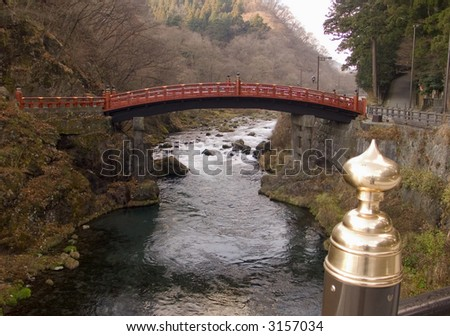traditional sacred red bridge across mountain river in Nikko, Japan