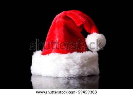 traditional santa claus hat, studio shoot isolated on black with reflection