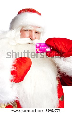 """Traditional Santa Claus holding and sowing credit card while giving a big """"ho ho ho"""" belly laugh. Isolated on white."""