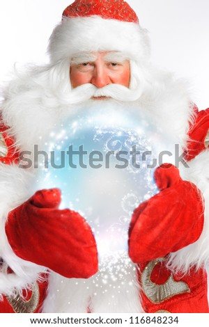 Traditional Santa Claus holding magic snowball Isolated on white