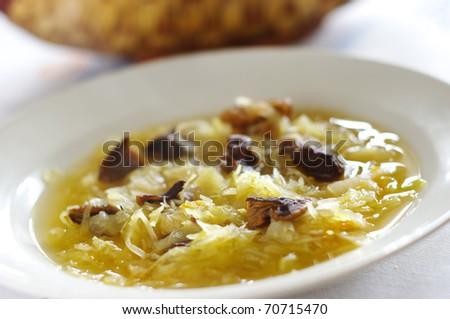 Traditional sauerkraut soup with mushrooms