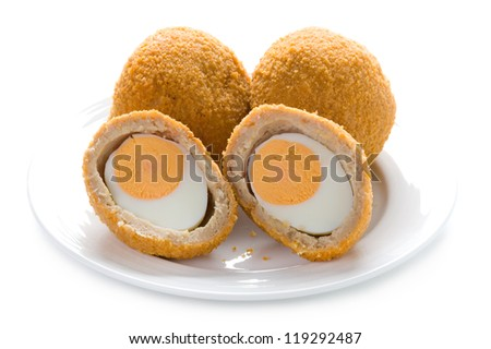 traditional scotch eggs on a plate isolated on white