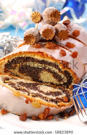 traditional sliced  poppy cake with icing and raisins for christmas