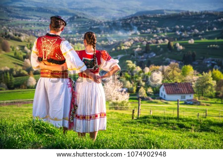 Traditional Slovak folk dress. Couple together in spring nature #1074902948