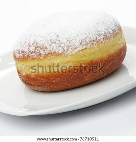 Traditional slovenian doughnut on white plate