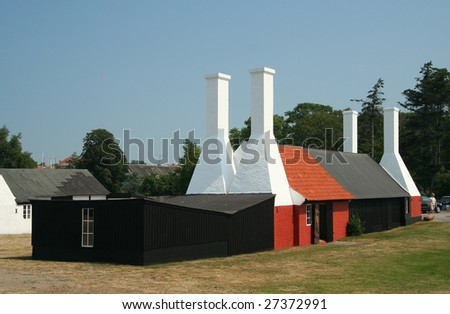 Traditional smokehouses in Bornholm, Denmark - stock photo