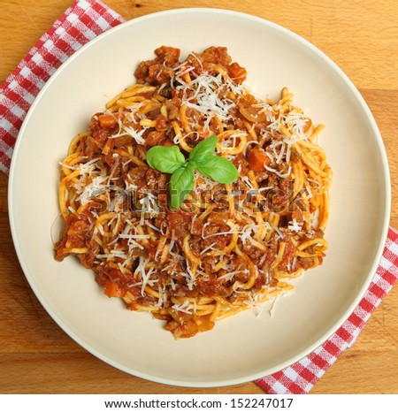 Traditional spaghetti bolognese with grated Parmesan cheese.