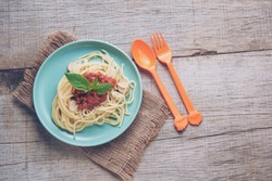 Traditional spaghetti with tomato sauce  - homemade healthy italian pasta on rustic wooden background