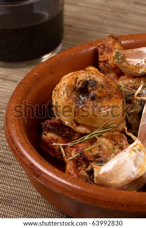 Traditional Spanish garlic chicken served in a clay pot