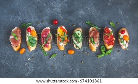 Traditional spanish tapas on black background. Flat lay, top view Foto stock ©