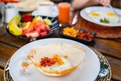 Traditional Sri Lankan breakfast with egg hoppers