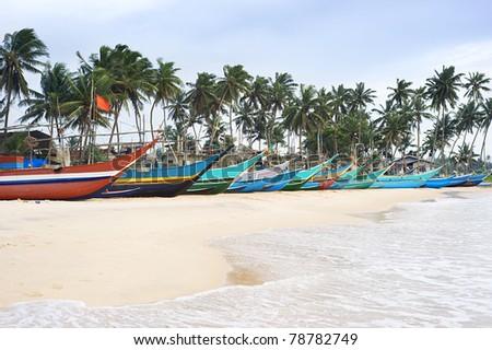 Traditional sri lankan fishing boats on ocean beach