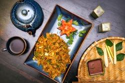 Traditional Sri Lankan kottu roti in wooden background