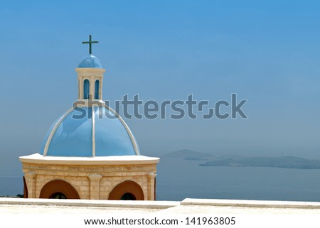 Traditional steeple over the Aegean sea at Syros island in Greece