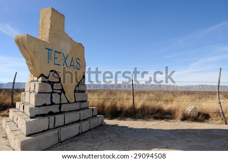 Traditional stone-made sign welcoming to the state of Texas on a rural road - stock photo