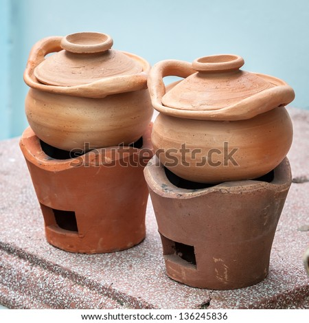 Traditional stoves and pots set made of red clay