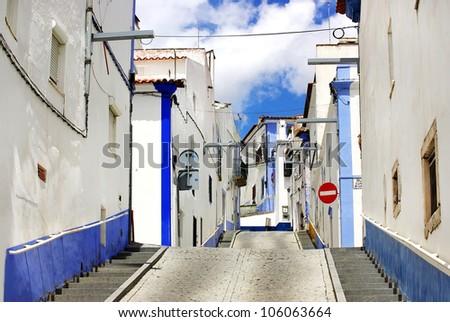 Traditional street of alentejo region, Arraiolos village. - stock photo