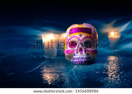 "Traditional sugar skull used at mexican offerings or ""ofrendas"" for Day of the Dead celebration. high contrast image"