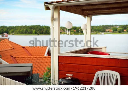 Traditional swedish houses colored with falu red dye. Tiled roofs. Empty street. Strängnäs, Mälaren lake, Sweden. Travel destinations, landmarks, sightseeing, vacations, recreation, estate, home Stock fotó ©