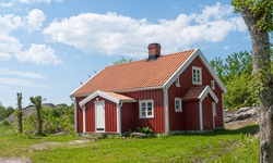 Traditional swedish red and white wooden house.