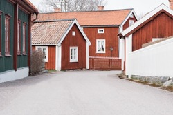 traditional Swedish street with red houses in Sweden
