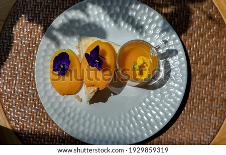 Traditional sweet dessert : Mayomgchid cheesecake on white plate. Delicious seasonal breakfast, Top view, Selective focus. Stok fotoğraf ©