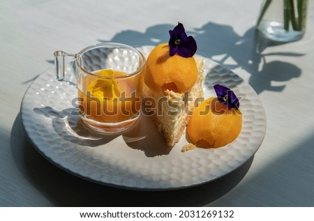 Traditional sweet dessert : Mayomgchid cheesecake on white plate, White table background. Delicious seasonal breakfast, Selective focus. Stok fotoğraf ©