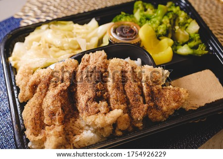 Traditional Taiwanese food bento lunch box, there is fried chicken fillet inside.