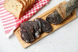 Traditional Tatar (Kazakh, Bashkir, Turkic, Uzbek) Food Dried Horse Meat Sausage - Kazy, Kazylyk Sliced With Spices On Wooden Board Grey Background. Top View, Copy Space.