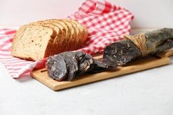 Traditional Tatar (Kazakh, Bashkir, Turkic, Uzbek) Food Dried Horse Meat Sausage - Kazy, Kazylyk Sliced With Slices Bread On Napkin, On Wooden Board Grey Background. Side View.