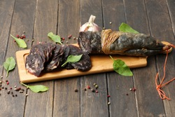 Traditional Tatar (Kazakh, Bashkir, Turkic, Uzbek) Food Dried Horse Meat Sausage - Kazy, Kazylyk Sliced With Spices On Wooden Board Background. Top View, Copy Space.