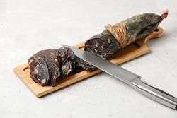 Traditional Tatar (Kazakh, Bashkir, Turkic, Uzbek) Food Dried Horse Meat Sausage - Kazy, Kazylyk Sliced On Wooden Board Grey Background. Top View.