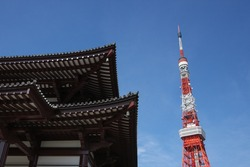 Traditional temple building and Red steel tower structure.