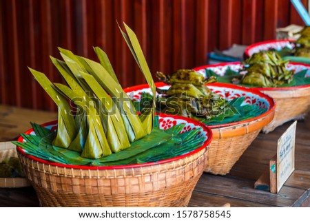 Traditional Thai dessert. Thai dessert on bamboo basket. Steamed Flour with Coconut Filling and Steamed Sticky Rice with Banana. #1578758545