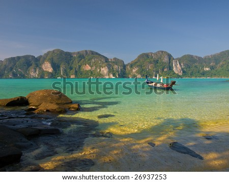 Traditional Thai longtail boat in a lagoon on Koh Phi-Phi Don island.