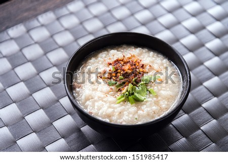 Traditional thai porridge rice gruel in bowl, con gee
