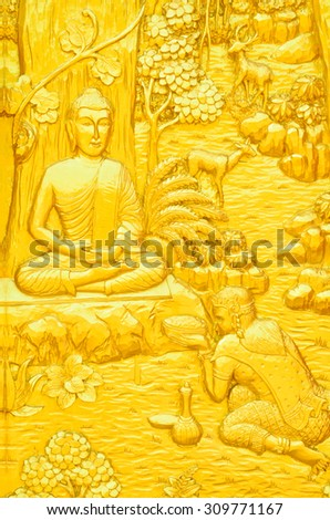 Traditional Thai style art carving of Buddha story on temple door