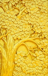 Traditional Thai style art golden tree carving on temple door