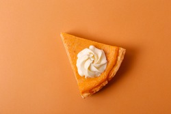 Traditional thanksgiving food on wooden table. Orange delicious homemade pumpkin pie with crust and decorative items. Thanksgiving table setting concept.Top view, close up, copy space, background.