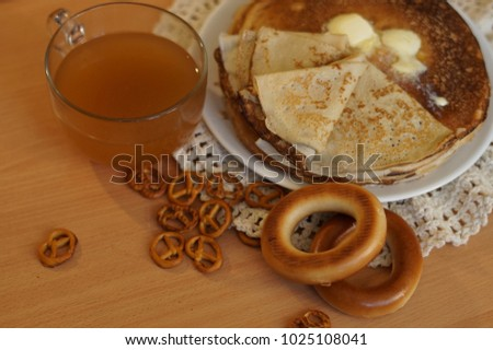 Traditional thin pancakes (fried pancakes) on a plate. Kvass in a glass Cup. Pancake week. #1025108041
