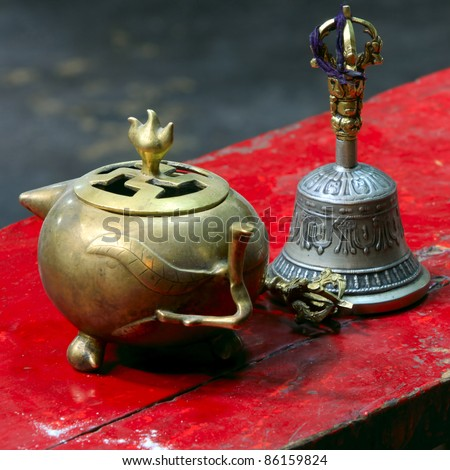 Traditional Tibetan bell, dorje and  precious pot, used in buddhist ceremonies. - stock photo