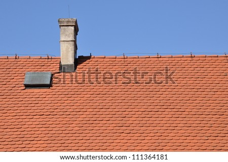 Traditional tile, red roof and blue sky