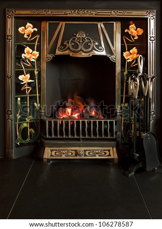 Traditional tiled fireplace with imitation coal fire - stock photo