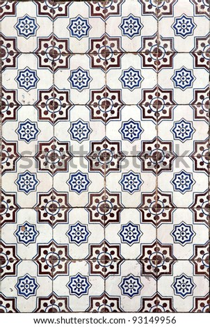 Traditional tiles (azulejos) on facade of old hosue in Lisbon, Portugal