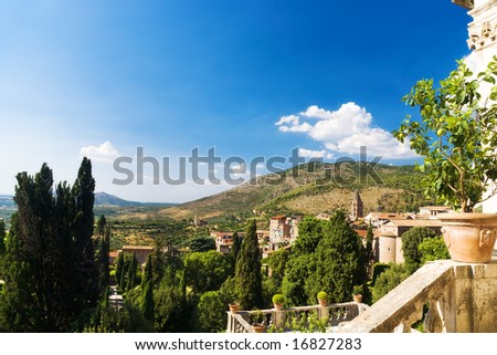 Traditional Toscana Italy landscape. Lemon tree and stairs on a foreground.