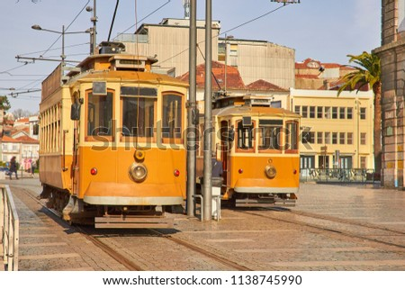 Traditional trams in old Porto city #1138745990