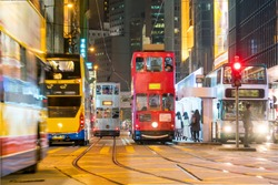 Traditional tramways cars in downtown Central area in Hong Kong