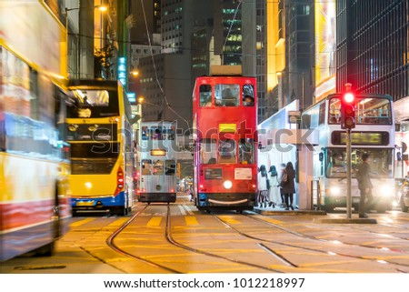 Traditional tramways cars in downtown Central area in Hong Kong - Shutterstock ID 1012218997